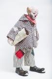 Muñeca hecha a mano de la porcelana de cerámica del payaso triste en el fondo blanco imagen de archivo libre de regalías