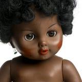 Muñeca negra usada delante de un fondo blanco Imagen de archivo libre de regalías