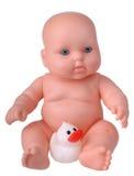 Muñeca plástica con el pato de goma Imagen de archivo