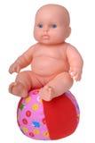 Muñeca plástica en la bola Imagen de archivo libre de regalías