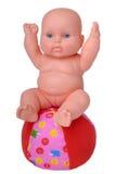 Muñeca plástica en la bola Imágenes de archivo libres de regalías