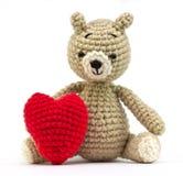 Muñeca sola del oso con el corazón Imagenes de archivo