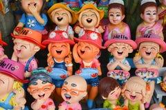 Muñeca sonriente y de risa de la arcilla Imágenes de archivo libres de regalías