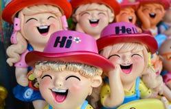 Muñeca sonriente y de risa de la arcilla, concepto de la felicidad Fotografía de archivo libre de regalías