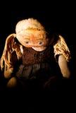 Muñeca triste vieja del paño con la luz #4 del punto fotografía de archivo