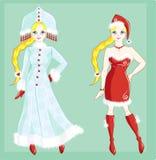 Muñeca vestida como muchacha de la doncella y de Papá Noel de la nieve Imagen de archivo libre de regalías