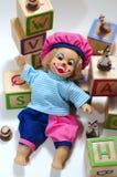 Muñeca y bloques de madera Foto de archivo libre de regalías