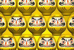 Muñecas amarillas de Daruma en amarillo Imagenes de archivo