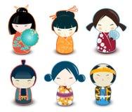 Muñecas de Kokeshi ilustración del vector