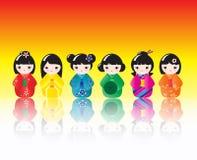Muñecas de Kokeshi reflejadas Imágenes de archivo libres de regalías