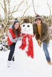 Muñeco de nieve adolescente del edificio de los pares Imagenes de archivo