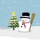 Muñeco de nieve con el árbol de navidad Foto de archivo