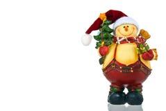 Muñeco de nieve con el árbol y el presente de Navidad Fotos de archivo libres de regalías