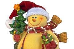 Muñeco de nieve con el árbol y el presente de Navidad Foto de archivo