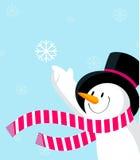 Muñeco de nieve con el copo de nieve. Fotos de archivo