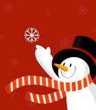 Muñeco de nieve con el copo de nieve. Rojo. Fotos de archivo