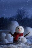 Muñeco de nieve con el fondo hivernal Imagenes de archivo