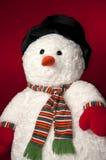 Muñeco de nieve con el fondo rojo - vertical Imagen de archivo