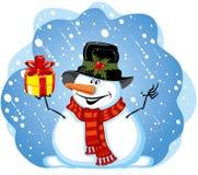 Muñeco de nieve con el regalo Fotos de archivo libres de regalías