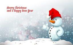Muñeco de nieve con el sombrero de Santa en invierno congelado Imagen de archivo libre de regalías