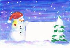 Muñeco de nieve con la luz de una vela que lleva a cabo la muestra en blanco Imagen de archivo libre de regalías