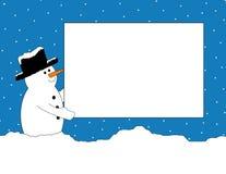 Muñeco de nieve con la muestra Foto de archivo libre de regalías