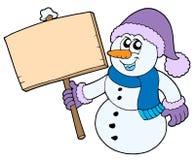 Muñeco de nieve con la muestra de madera Foto de archivo libre de regalías