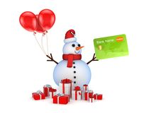 Muñeco de nieve con la tarjeta de crédito y los rectángulos de regalo. Fotografía de archivo libre de regalías