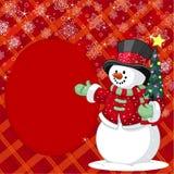 Muñeco de nieve con la tarjeta del lugar del árbol de navidad Imagenes de archivo