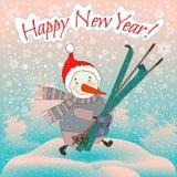 Muñeco de nieve con los esquís Imagenes de archivo
