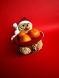 Muñeco de nieve con los mandarines Fotografía de archivo