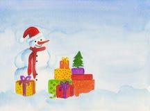 Muñeco de nieve con los regalos Fotografía de archivo
