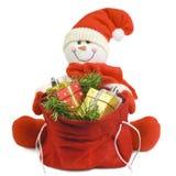 Muñeco de nieve con los regalos Fotos de archivo