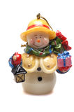 Muñeco de nieve con los regalos de la Navidad imagenes de archivo