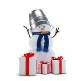 Muñeco de nieve con un cubo y los regalos Fotos de archivo libres de regalías