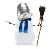 Muñeco de nieve con un cubo y una escoba Fotos de archivo libres de regalías