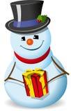 Muñeco de nieve con un regalo Imagen de archivo libre de regalías