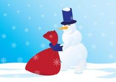 Muñeco de nieve con un saco de regalos Imágenes de archivo libres de regalías