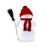 Muñeco de nieve con una escoba Foto de archivo