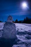 Muñeco de nieve con una Luna Llena Fotografía de archivo