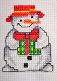 Muñeco de nieve cosido cruz Fotos de archivo