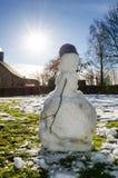 Muñeco de nieve de fusión Imagen de archivo libre de regalías