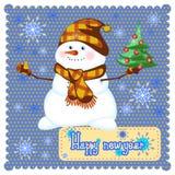 Muñeco de nieve de la Feliz Navidad con el árbol de navidad Fotos de archivo libres de regalías