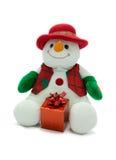 Muñeco de nieve de la Navidad con el presente. Imagen de archivo