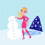 Muñeco de nieve de la Navidad del invierno del edificio de la mujer Imagenes de archivo