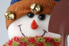 Muñeco de nieve de la Navidad en el fondo blanco Foto de archivo