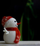 Muñeco de nieve de la Navidad en fondo del bokeh Fotografía de archivo