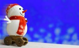 Muñeco de nieve de la Navidad en fondo del bokeh Fotos de archivo
