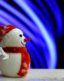 Muñeco de nieve de la Navidad en fondo del bokeh Imagen de archivo
