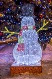Muñeco de nieve de las iluminaciones de la Navidad Imágenes de archivo libres de regalías